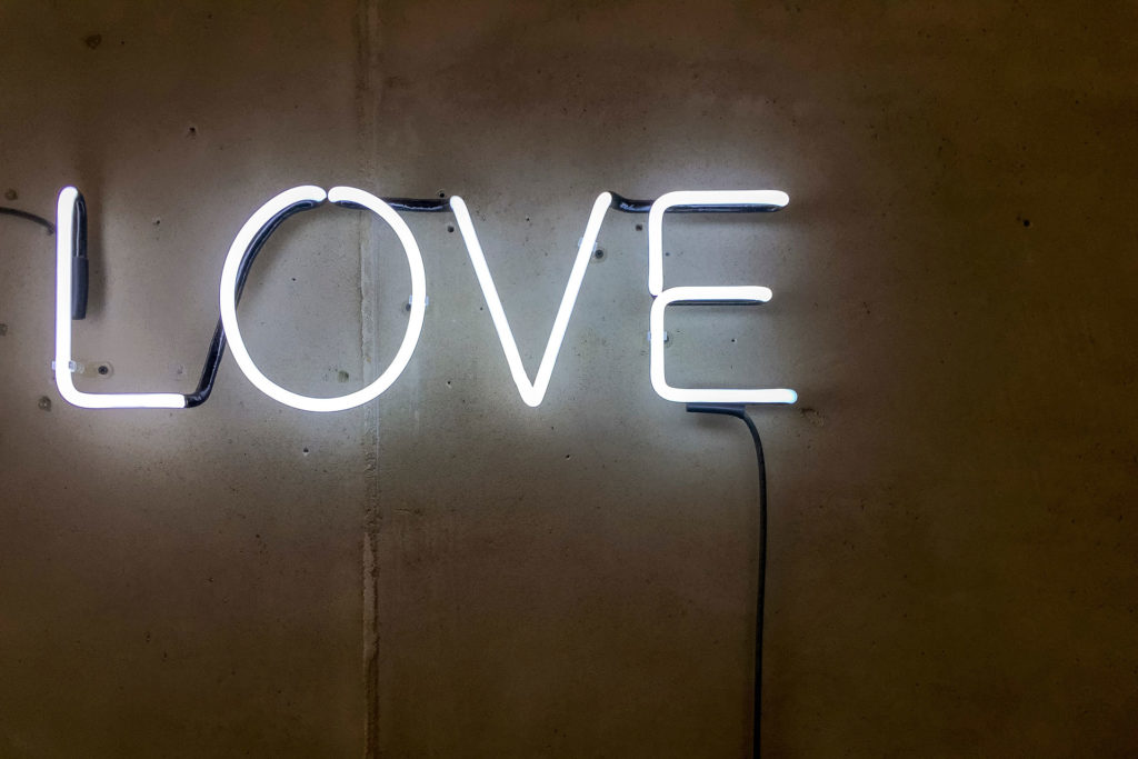 Love neon sign Photo by Etienne Girardet